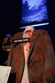 The Bullet-Riddled Zombie fashion line from the Resident Evil: Raccoon City maze. Stylish, yet bloody.