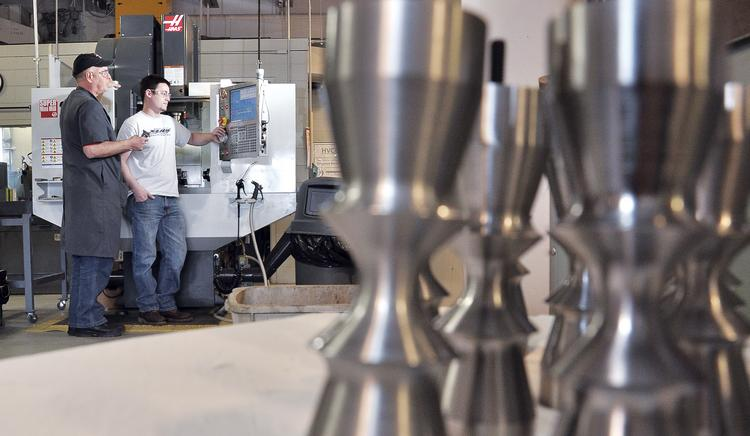 From left, David Larkin, a professor in the manufacturing program at Hudson Valley Community College in Troy, works with student Nick Stack.