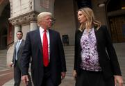 Donald Trump, left, in discussion with daughter Ivanka, who is eight months pregnant and, according to dad, wasn't supposed to be at the event until she insisted.