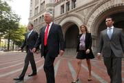 From left, Eric Trump, Donald Trump, Ivanka Trump and Donald Trump Jr. as they leave the Old Post Office Pavilion. The Trump Organization hopes to start construction as early as the first or second quarter of next year.