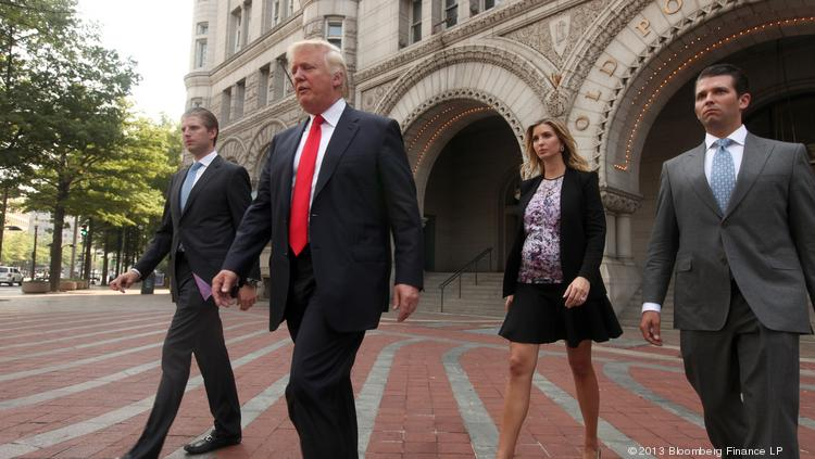 The Trumps are now fully in control of the Old Post Office building for its conversion, as we've told you, into a fancy, high-end 271-room hotel, to open at the start of 2016. Here, Donald Trump, second from left, walks with sons Eric Trump, left, Donald Trump Jr., right, and daughter Ivanka Trump, walk outside the Old Post Office Pavilion following a news conference Tuesday, Sept. 10, 2013, when Trump announced the signing of the agreement with the U.S. government to turn the historic building into a luxury hotel,  Photographer: Julia Schmalz/Bloomberg