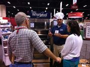 Hundreds of vendors presented their products at the Ace Hardware fall convention. Bob Colby of Saleslink promoted Whirlpool's Aqualift feature, which makes cleaning an oven easier and faster.