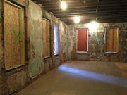 Here's the interior of what will become a first-floor apartment. Wallpaper is still visible on top of the brick.