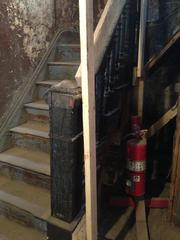 This staircase was damaged in a fire. HGC Construction braced the staircase and will save it.