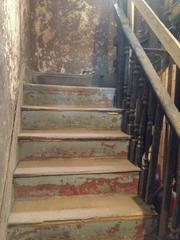 An original feature of the building, HGC Construction will restore this fire-damaged staircase.