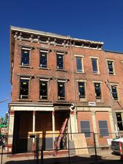 Work on this building at the corner of Mercer and Walnut streets will include removing the brick that was added on the first floor - notice the difference between it and the original brickwork above - and restoring the storefronts that used to be there.