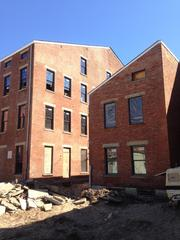 The area behind these historic buildings will become a courtyard for residents.