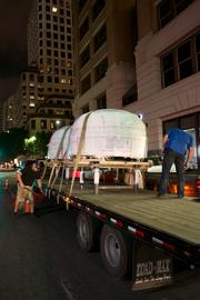 The specialty ovens for baking Roman-styled and Neopolitan-styled pizza arrive late at night at the Littlefield Building on East Sixth Street.