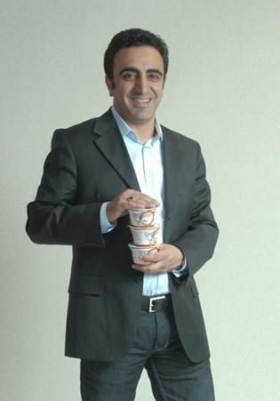 Hamdi Ulukaya is pictured here holding his favorite yogurt, Chobani, for a photo accompanying his 2009 40 Under Forty profile.