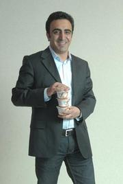 Greek yogurt Johnstown was once known for glove-making. Today, it's Greek food—yogurt and feta cheese—giving the Fulton County city a boost. The companies that make FAGE and Chobani yogurt have operations in Johnstown, supplying hundreds of jobs. Pictured is Hamdi Ulukaya, who founded Agro Farms, maker of Chobani yogurt and other products.