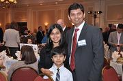 Preetham Morkonda, of Documentation Strategies and a member of the 2012 class, at the event with wife Deepthi and 6-year-old son, Akkhil.