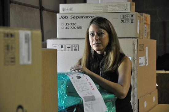 Dawn Abbuhl, president of Repeat Business Systems, expects to close 2012 with revenue of $9.2 million, up from $8.6 million a year ago. Acquiring IT companies is part of plan to diversify offerings, which include office equipment, hardware, software and consulting services.