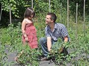 Franco Rua and his daughter, Mia, at the restaurant's larger garden in Watervliet.