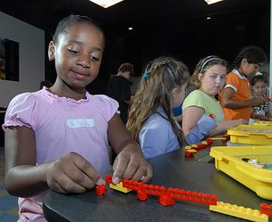 The Children's Museum of Science and Technology, children at an Intro to Robotics summer camp class