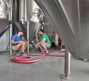 Brewmaster and co-owner George de Piro (left) with co-owner Brian Martell in what will be Druthers Brew Pub's brewing area.