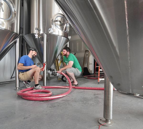 Co-owner and chief brewing officer George de Piro, left, and co-owner Brian Martell, at work in the Druthers brewery.