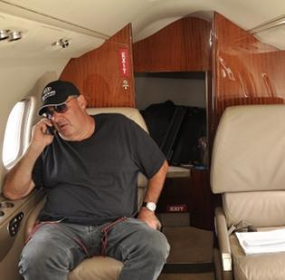 Billy Fuccillo, moments after he arrives in his jet from Fort Myers, Fla., on July 21, the day before track season opened at Saratoga Race Course. The flight takes 2 1/2 hours. Fuccillo and his two pilots were the only people on board that day.