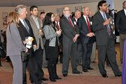 VIP guests, including Albany Mayor Jerry Jennings, listens as CDPHP CEO John Bennett welcomes them to a reception for Dr. Atul Gawande (far right)