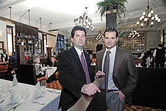 Bobby (right) and John Mallozzi, co-owners of the Mallozzi Group, are closing their Brown Derby restaurant in Albany.