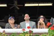 (from left) Repole's grandmother, Repole and his wife, Maria, get ready to watch his horse Hobbs run in an Aug. 31 race at Saratoga.