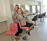 Rumors Inc. owners (left) Marri Aviza and Lisa Norgrove in the salon's new blow-dry room. The pair, who opened Rumors in 1987, invested $3 million to build their new location.