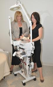 Co-owner Marri Aviza, left, with aesthetician Caitlin Murray with Rumors' newest skin care equipment.