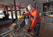 Michael Belanger, owner of Marco Polo Holdings, works on a cabinet for Shirley's Cafe. The cafe will fill a void after the Jonesville Store closed earlier this year.