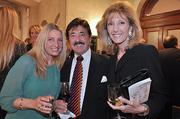 Jennifer Corona (left), Vincent Sfara and Karen Smith-Sfara at Thursday's opening reception for the three-day Wine & Dine for the Arts. Smith-Sfara, a founding member of the festival, is principal at K. Smith-Sfara and Associates, an Albany marketing firm.