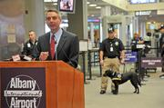 Brian Johansson, TSA federal security director for Albany International Airport, talks about the airport's new canine program. In the background is Zelda, a 3-year-old Labrador retriever trained to sniff for explosives.
