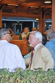 Scott Johnson (in tie), mayor of Saratoga Springs, enjoys the weekend's horse auctions at the Fasig-Tipton Co. sales facility.