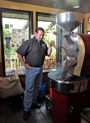 Frank Figliomeni roasts beans at his coffee shop, Professor Java's Coffee Sanctuary.
