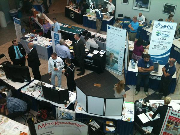 Businesspeople check out tables set up at the smAlbany event held at the College of Nanoscale Science and Engineering on July 17.
