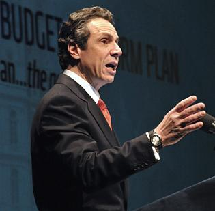 Gov. Andrew Cuomo says the new exchange, mandated by federal health reform, will lower health insurance rates for businesses.
