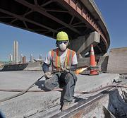 Tom Subik, of Harrison & Burrowes Bridge Constructors, at work on the Dunn Memorial Bridge. The company says the $11.6 million of repairs are 35 percent complete.