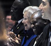 State University of New York Chancellor Nancy Zimpher applauds after the singing of the The Star Spangled Banner