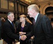State Assemblyman John McDonald (left) greets Sage Colleges President Susan Scrimshaw and her husband, Allan Stern