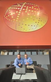 "Scott Rajeski of GlobalFoundries describes himself as ""a workaholic."" Rajeski was CFO at GE Silicones, Momentive and Latham International before getting a call from GlobalFoundries. Here he is pictured with James DePasquale (left), manager of finance."