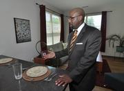 Quintin Bullock, president of Schenectady County Community College, in a four-bedroom suite of the new student housing.