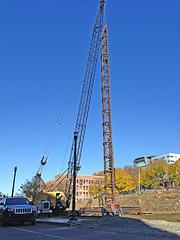 A crane towers over the site in downtown Troy where a 48-unit graduate student apartment building called CityStation East will be built on Sixth Avenue. The general contractor is BBL Construction Services LLC.