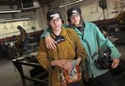 Twins Lia, left, and Logan Smaka take a quick break at the Modern Welding School.