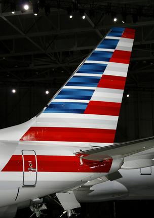 The tail of an American Airlines Inc. jet. American Airlines unveiled the first change in its aircraft graphics in over 40 years.