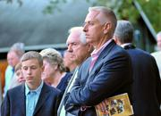 Thoroughbred trainer Todd Pletcher, right, and his father, J.J. Pletcher, watch the sales Monday at the Fasig-Tipton auction house in Saratoga Springs.