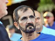 Sheikh Mohammed bin Rashid al Maktoum is surrounded by his guards and advisors as he awaits the start of the annual summer thoroughbred auction in Saratoga Springs. Through his bloodstock agent, John Ferguson, the sheikh bought the most expensive yearling on Monday, a colt that sold for $1.2 million.