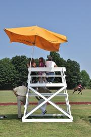 The polo managers have a bird's-eye view of the action as they keep 