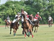 "The action on a polo field is intense. The field measures 160 yards by 300 yards, or nine acres. Players mount a new horse at the end of every period, or ""chukker,"" because it's so tiring."