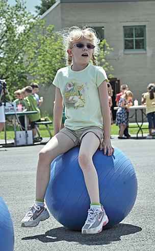 Katie VanSteele bounces around during recess at Glenmont Elementary School. The school is part of the Bethlehem Central School District which ranked No. 1 for the second year in a row.