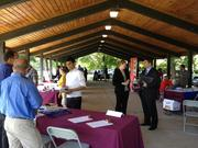 Company representatives speak with job seekers at the Arsenal Business & Technology Partnership's career fair at Hudson Shores Park in Watervliet on Thursday.