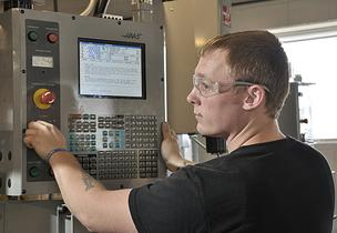 "Dave Wilson, a senior in Hudson Valley Community College's Manufacturing Technical Systems Program, operates a computer numerical control (known in manufacturing circles as ""CNC"") vertical milling machine."