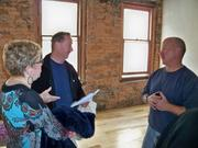 Keith Holmes (right), in charge of the renovations at 518 Broadway in downtown Albany, New York, talks to Mitch Grossman, of Chatham, and his fiancee, Phyllis Shapiro, about the one- and two-bedroom units that will be available soon. Rents start at $750.