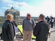"Brian Meurs, center, of Colonie takes in the view atop 17 Chapel in downtown Albany, New York. Meurs said the 24-unit condominium tower was ""absolutely gorgeous"" but he's not planning to buy at this time."